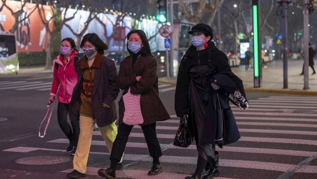 ep february 25 2020 - shanghai china pedestrians wear surgical masks as protection against the