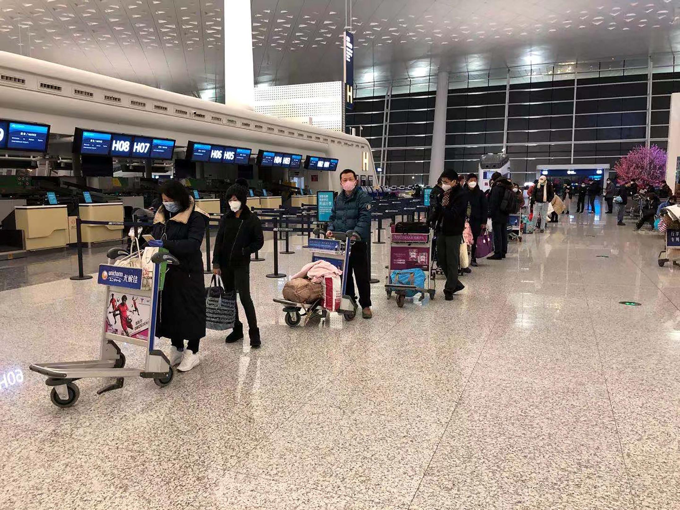 coronavirus-avion-cargo-passagers-rapatriement-ressortissants-americains-aeroport-wuhan-chine