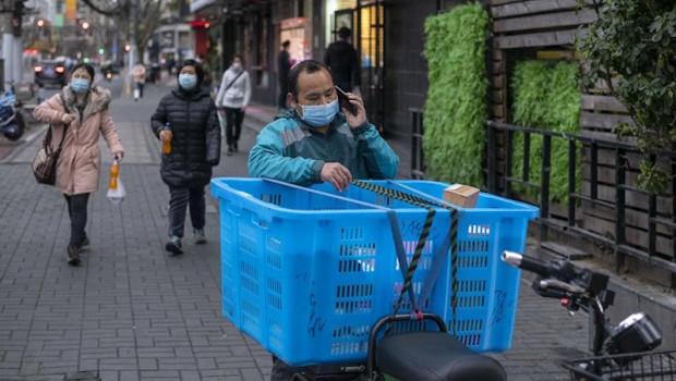 ep ciudadanos con mascarillas en shanghai
