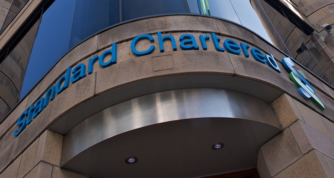 Standard Chartered slides on lack of dividend payout